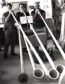 3 guys spieling alphorns